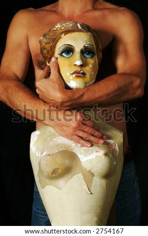 Body of man with arms embracing figure of woman
