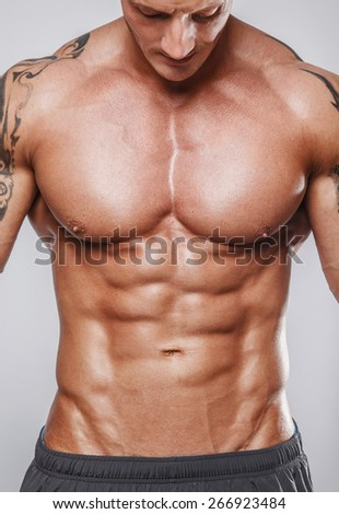 Body of muscular male with great physique - stock photo
