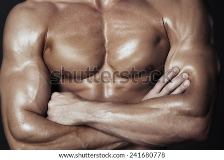 Body of muscular man. Horizontal studio shot - stock photo