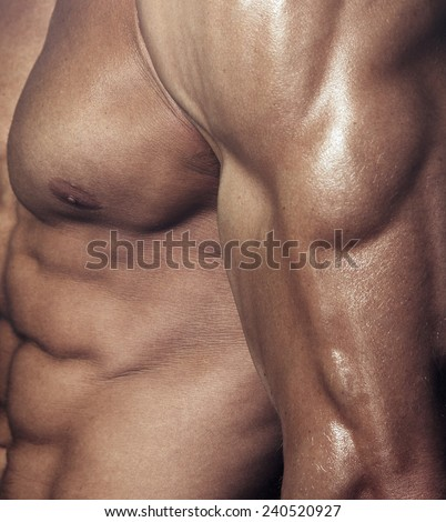 Body of muscular man. Vertical studio shot
