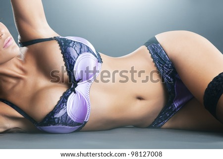 Body of sexy woman with long hair in purple lingerie - stock photo