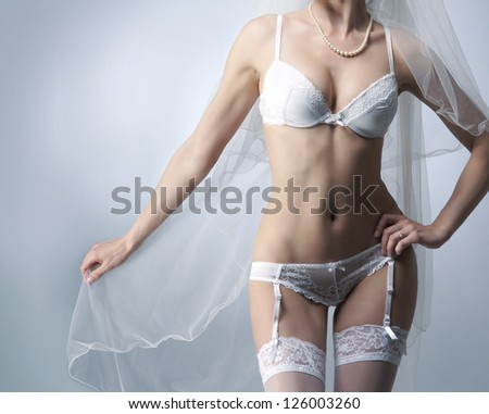 Body of young, beautiful and sexy bride in erotic lingerie - stock photo