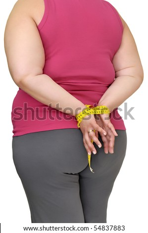 Body part of a fat woman with hands tied up with measuring tape - stock photo