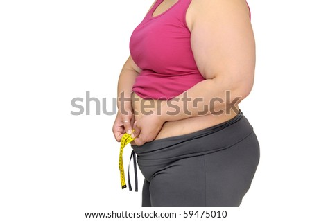 Body part of a fat woman with measuring tape - stock photo
