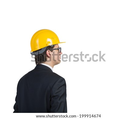 Body side picture of a businessman in a yellow helmet, isolated.