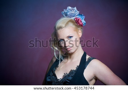 body type concept - smiling young woman over blue holidays dark background