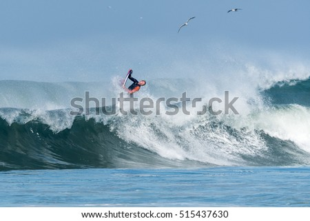 Bodyboarder in action on the ocean waves on a sunny day.