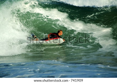 bodyboarder riding the surf