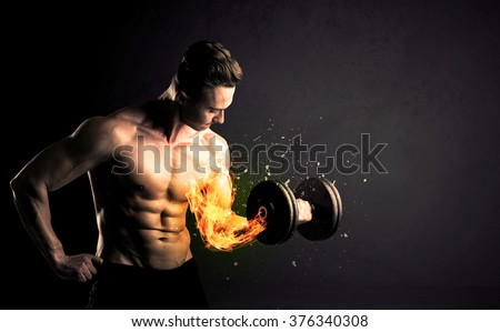 Bodybuilder athlete lifting weight with fire explode arm concept on background - stock photo