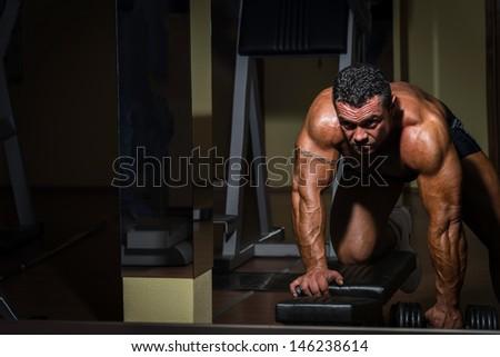 bodybuilder doing heavy weight exercise for back - stock photo