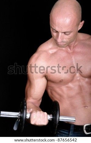 bodybuilder dumbbell on black background - stock photo