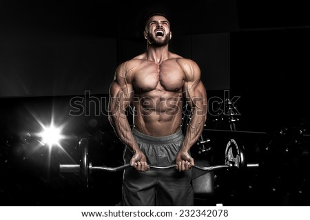 Bodybuilder in the gym - stock photo