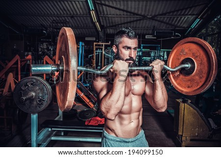 bodybuilder in training room  - stock photo