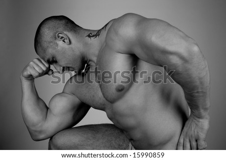Bodybuilder is thinking about calories - stock photo