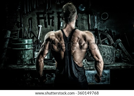 Bodybuilder male model posing - back - stock photo
