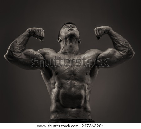 Bodybuilder male posing showing his huge muscules - stock photo