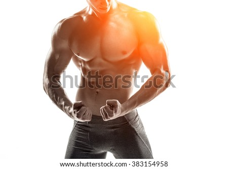 Bodybuilder man posing, showing perfect abs, houlders, biceps, triceps, chest - stock photo
