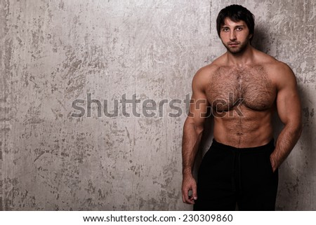 Bodybuilder. Man with hairy chest