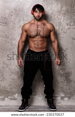 Bodybuilder. Man with red headset