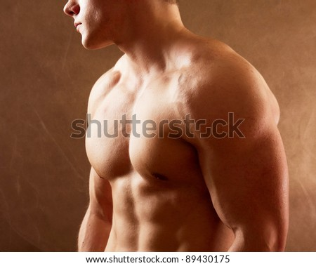 Bodybuilder on beige background