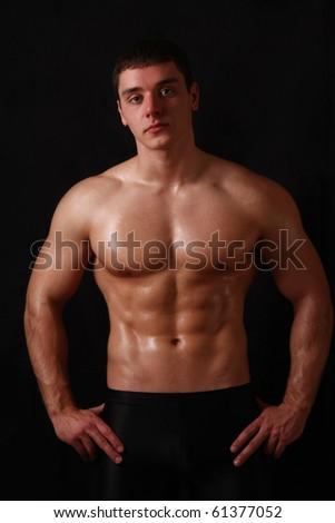 Bodybuilder on black background - stock photo