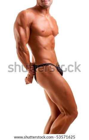 bodybuilder posing -flexing his tricep - stock photo