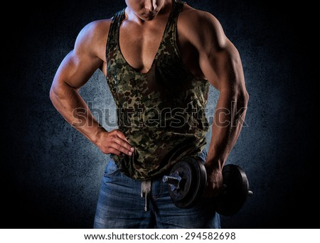 bodybuilder posing. Handsome power athletic guy male. Fitness muscular body