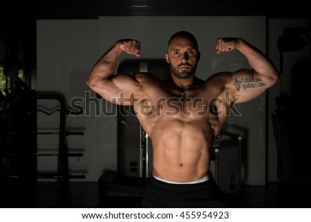 Bodybuilder Posing - Handsome Power Athletic Guy Male - Fitness Muscular Body