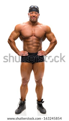 Bodybuilder posing on a white background - stock photo
