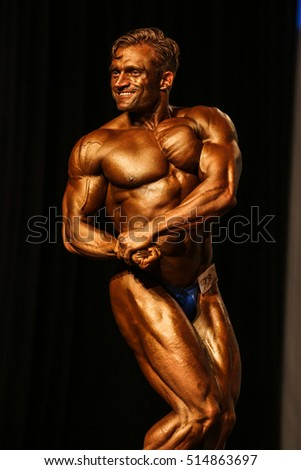 Bodybuilder posing on the stage
