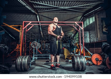 Bodybuilder preparing for deadlift of barbell  - stock photo