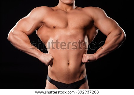 Bodybuilder's front lat spread pose. Close-up of front lat spread. Show us the lat width. The v-shaped torso.