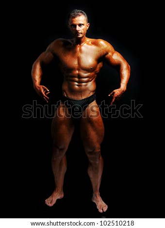 Bodybuilder strong as a rock