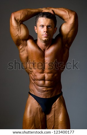 bodybuilder strong athletic man show muscle arm, sport guy showing his male muscles