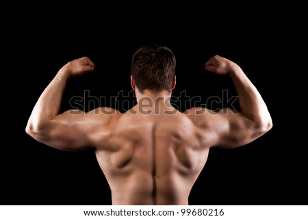 bodybuilder strong athletic muscle man, sport guy showing his male muscles, standing back over black background