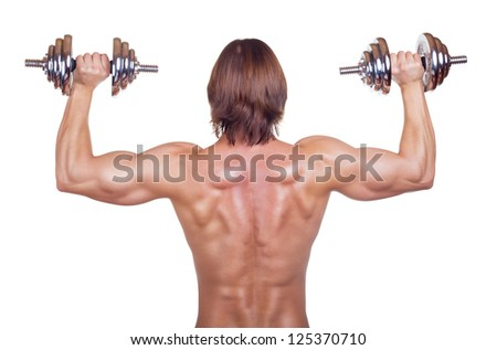 Bodybuilder training with dumbbells isolated on white background. Rear view - stock photo