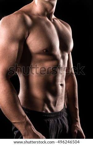 bodybuilder upper body below the neck isolated with black background
