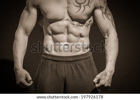 bodybuilder with tatoo posing