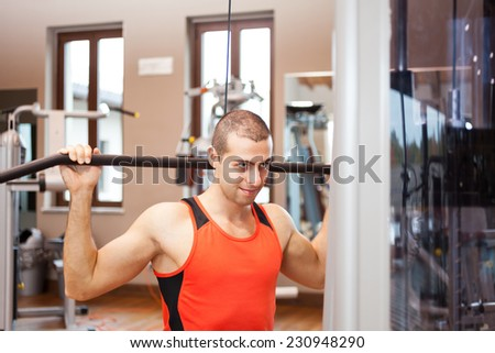 Bodybuilder working out in a gym - stock photo