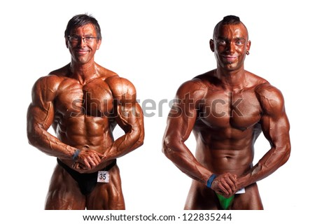 bodybuilders posing over white background