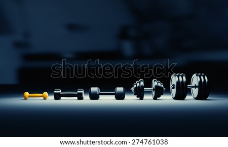 Bodybuilding progress illustration with growing dumbbells size.  - stock photo