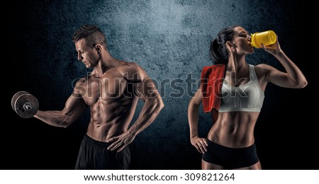 Bodybuilding. Strong man and a woman posing on a dark background - stock photo