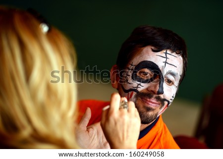 Bodypainting. Man in day of the dead mask skull face art  - stock photo