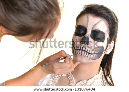 Bodypainting. Woman in day of the dead mask skull face art - stock photo