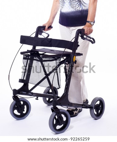 Bodypart of elderly woman sitting on a modern walker