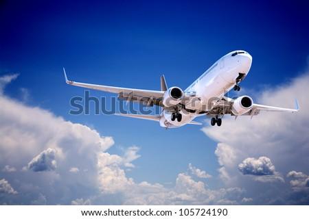 Boeing 737 jet aeroplane landing through gap in stormy sky. - stock photo