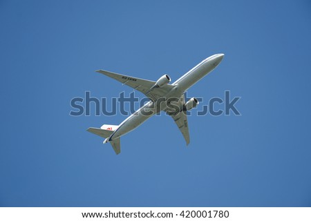 BOEING 777 - MAY 13, 2016: Air China Boeing 777-39l is in the operation since May 14, 2012. The aircraft above Vancouver YVR, has typical capacity 440 passengers and maximum range 10,000 kilometres.  - stock photo