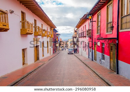 BOGOTA, COLOMBIA - FEBRUARY 25, 2015: Very charming colorful street with spanish influenced architecture located in the old parts of Bogota city - stock photo