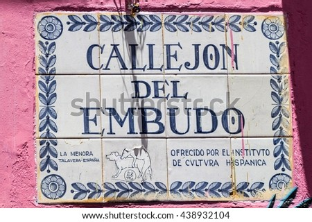 BOGOTA, COLOMBIA - SEPTEMBER 24, 2015: Small graffiti on a street name sign in the La Candelaria neighborhood of Bogota, capital of Colombia.