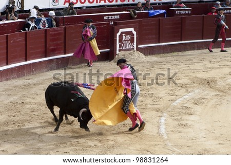 BOGOTA, COLUMBIA - JANUARY 18: A Colombian bullfighter was performing in the Plaza de Toros on January 18, 2009 in Bogota, Colombia.The popular bullfighting competition is held annually in Plaza de Toros. - stock photo